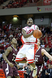 05 January 2008:  Osiris Eldridge gets in front of Tyrone Green and Matt Shaw and launches for the basket. The Redbirds of Illinois State took the bite out of the Salukis of Southern Illinois winning the Conference home opener for the 'birds on Doug Collins Court in Redbird Arena in Normal Illinois by a score of 56-47.
