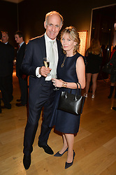 ROBIN & LUCY SMITH-RYLAND at a party to celebrate the publication of Capability Brown & Belvoir - Discovering a lost Landscape by The Duchess of Rutland, held at Christie's, 8 King Street, St.James, London on 7th October 2015.
