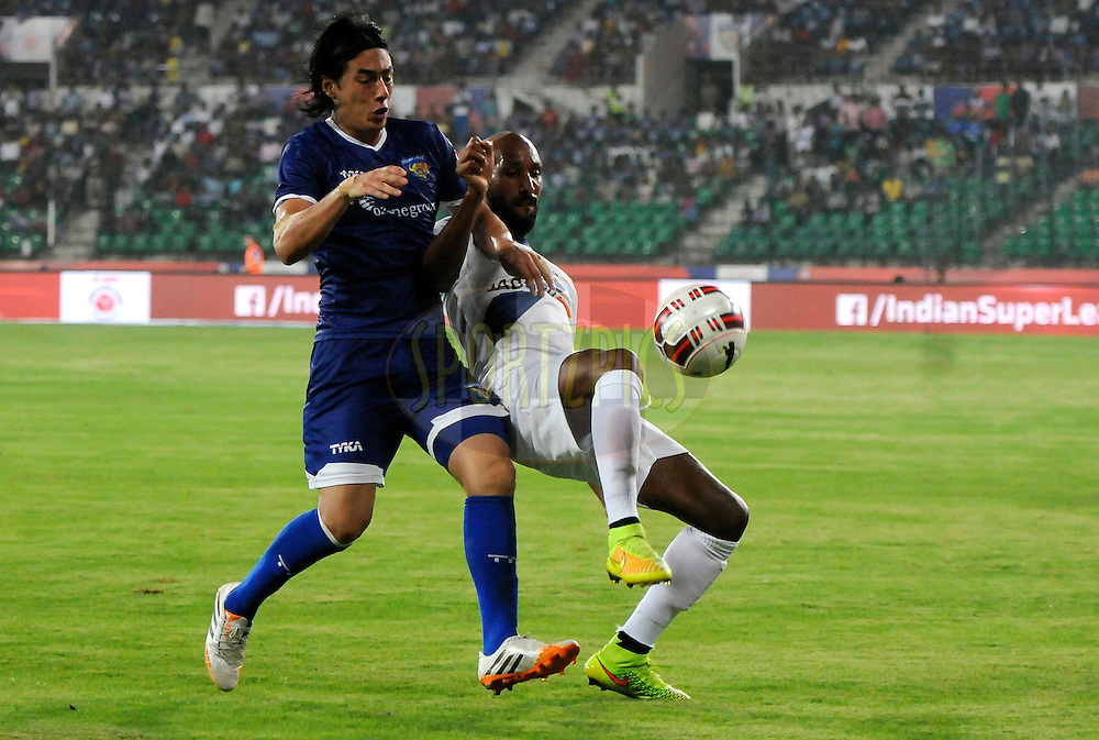 Nicolas Anelka of Mumbai City FC and Jairo Andres Suarez Carvajal of Chennaiyin FC in action during match 15 of the Hero Indian Super League between Chennaiyin FC and Mumbai City FC held at the Jawaharlal Nehru Stadium, Chennai, India on the 28th October 2014.<br /> <br /> Photo by:  Pal Pillai/ ISL/ SPORTZPICS