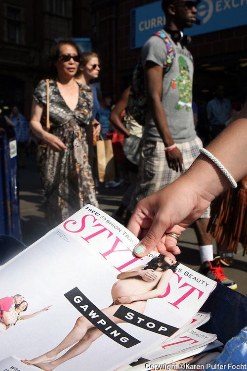 "Hawkers give away a current issue of Stylist magazine in the streets of London, England, recently. The current issue features a naked pregnant woman and talks about her ""bump"" on the cover. Citizens and visitors to England have been awaiting the delivery of the royal baby."
