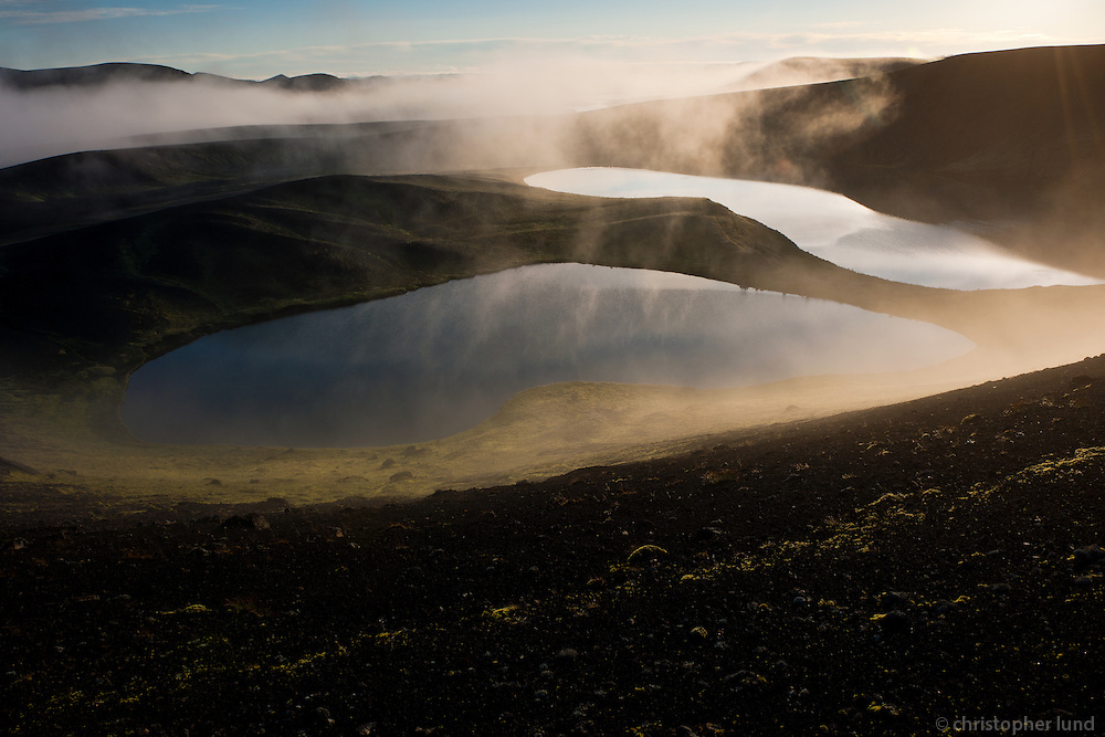 Veidivötn, The fishing lakes, a row of water filled explosion craters. These craters belong to a system of volcanic fissures reaching from Landmannalaugar in the south west, through Bardarbunga in the north west part of the Vatnajökull ice sheet, to Dynjguhals south of the volcanic massif Askja. A major eruption, the fourth largest in Iceland since the settlement, took place on this fissure system in 1477. Veiðivötn eru vatnaklasi á Landmannaafrétti, sem samanstendur af allt að fimmtíu vötnum, bæði smáum og stórum. Mörg vötnin eru sprengigígar sem mynduðust í Veiðivatnagosinu 1477.