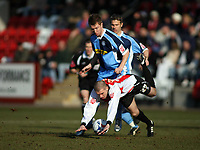 Dean Bowditch standing for Wycombe, and Steven Gillespie  falling over for Cheltenham<br /> <br /> Photo: Richard Eaton.<br /> <br /> Cheltenham Town v Wycombe Wanderers. Coca Cola League 2. 04/03/2006.