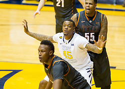West Virginia Mountaineers forward Elijah Macon (45) tries to make position on Texas Longhorns center Cameron Ridley (55) during the second half at the WVU Coliseum.