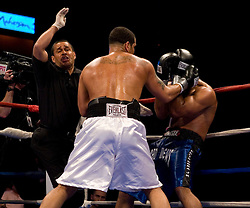 Apr 6, 2007; Uncasville, CT, USA; Referee Eddie Claudio stops the bout between Matt Godfrey (white trunks) and Felix Cora Jr. (blue trunks) in the second round of their 12 round NABF and NABA Cruiserweight title bout at the Mohegan Sun Arena.  Godfrey won via 2nd round TKO.