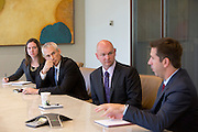 Amy Luberto, Evan Inglis and Dave Wilson listen to James Colon give remarks during an interview at Nuveen Asset Management in downtown Chicago, Ill., on Wednesday, September 23, 2015.