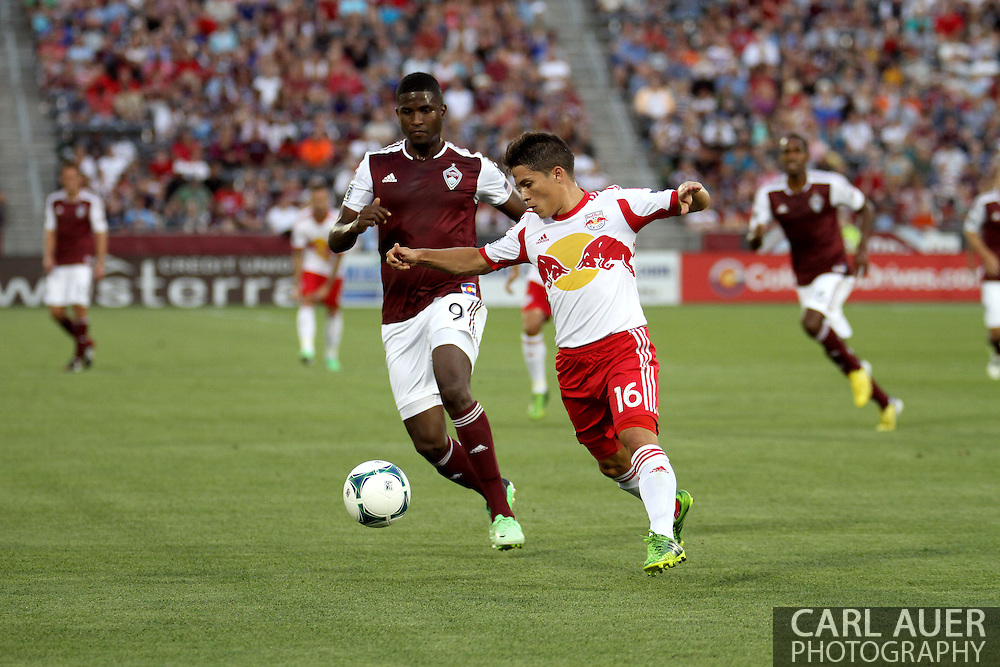 July 4th, 2013 - New York Red Bulls defender Connor Lade (16) beats Colorado Rapids forward Edson Buddle (9) to the ball in first half action of the Major League Soccer match between New York Red Bulls and the Colorado Rapids at Dick's Sporting Goods Park in Commerce City, CO