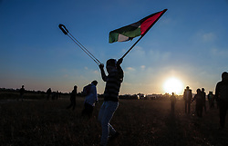 March 22, 2019 - Gaza, Palestine, Palestine - A Palestinian seen using a slingshot during the clashes..Palestinian protesters clash with Israeli troops following the tents protest where Palestinians demand the right to return to their homeland at the Israel-Gaza border, in Khan Younis in the southern Gaza Strip. Two Palestinians were killed by Israeli fire during the clashes, the health ministry in Hamas-run enclave said. (Credit Image: © Yousef Masoud/SOPA Images via ZUMA Wire)