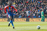 Crystal Palace defender Aaron Wan-Bissaka (29) attacks as Crystal Palace goalkeeper Vicente Guaita (31) appears to take a break in the distance during the Premier League match between Crystal Palace and Manchester City at Selhurst Park, London, England on 14 April 2019.