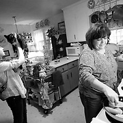 "Linda Vandenberg makes dinner with her daughter Julianna at their home with food their received from the food bank.  ""We don't want to be rich.  I just want to pay my bills and go to the grocery store and fill my basket,"" said Linda."