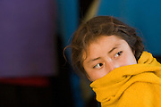 "26 APRIL 2005 - SAN CRISTOBAL DE LAS CASAS, CHIAPAS, MEXICO: A teen age girl at a Catholic mass in the Chumalan Indian community of Bautista Chico near San Cristobal de las Casas, Chiapas, Mexico. The Catholic Church in the Chiapas highlands is facing a threat from evangelical Protestant churches, which are experiencing explosive growth, and from ""traditionalist"" Catholic churches, which are not affiliated with the San Cristobal diocese and are controlled by local politicians and powerful indigenous leaders affiliated with the politicians. The traditionalists burn down churches and chapels affiliated with the diocese, threaten the priests and put indigenous men who worship with the diocese in jail.  PHOTO BY JACK KURTZ"