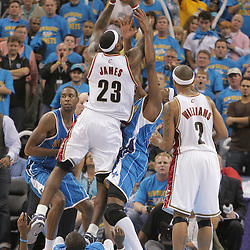 01 November 2008:  Cleveland Cavaliers forward LeBron James (23) draws a charging foul as he attempts to shoots over New Orleans Hornets forward James Posey (41) and Chris Paul (on floor) during a 104-92 win by the New Orleans Hornets over the Cleveland Cavaliers at the New Orleans Arena in New Orleans, LA..