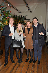 Left to right, FREDDIE JOHNSON, SOPHIE KIRK, EMILY BULL and CHRISTOPHER DODDS at a private view of photographs by renowned wildlife photographer David Yarrow in aid of TUSK entitled 'Wild Encounters' held at Somerset House on 19th September 2016.