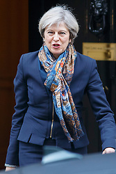© Licensed to London News Pictures. 24/01/2017. London, UK. Prime Minister THERESA MAY leaves Downing Street to attend House of Commons following the government's defeat in the Supreme Court ruling that formal process for the UK to leave the European Union, cannot be triggered without a vote in Parliament. Photo credit: Tolga Akmen/LNP