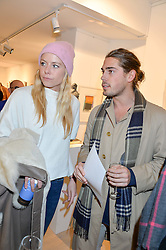 OCTAVIA ANSTRUTHER-GOUGH-CALTHORPE and COSMO BARRAN at a private view entitled Stop Making Sense featuring work by Georgiana Anstruther and Carol Corell held at Lacey Contemporary, 8 Clarendon Cross, London on 9th March 2016.