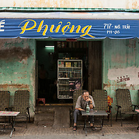 A man drinks at a small cafe in Ho Chi Minh City, Vietnam.