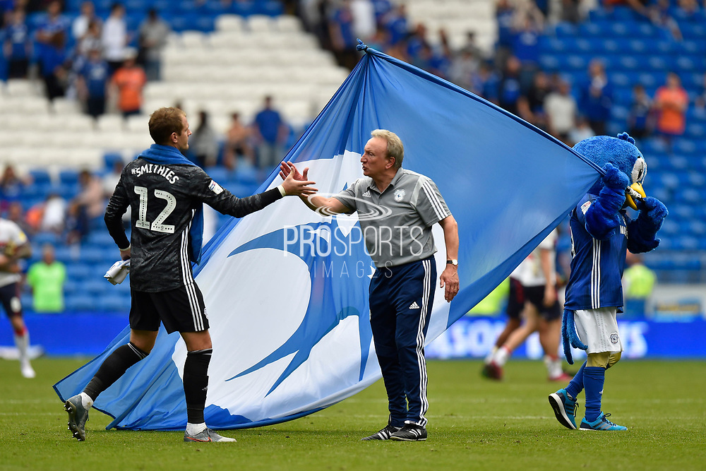 Cardiff City manager Neil Warnock congratulates goalkkeper Alex Smithies (12) of Cardiff City at full time after the 1-0 win over Middlesbrough during the EFL Sky Bet Championship match between Cardiff City and Middlesbrough at the Cardiff City Stadium, Cardiff, Wales on 21 September 2019.