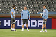 CAPE TOWN, SOUTH AFRICA - 10 JUNE 2010, Sebastian Eguren, Diego Perez  and Diego Godin chat during the Uruguay training session held at the Cape Town Stadium. Uruguay play France in their opening game on Friday 11 June 2010. Photo by: Shaun Roy/Sportzpics
