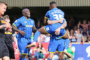 Toyosi Olusanya striker for AFC Wimbledon (35) celebrates after making it 1-0 during the Sky Bet League 2 match between AFC Wimbledon and Newport County at the Cherry Red Records Stadium, Kingston, England on 7 May 2016. Photo by Stuart Butcher.