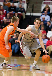 December 16, 2009; Stanford, CA, USA;  Stanford Cardinal guard Drew Shiller (10) dribbles past Oklahoma State Cowboys guard Keiton Page (12) during the first half at Maples Pavilion.  Oklahoma State defeated Stanford 71-70.