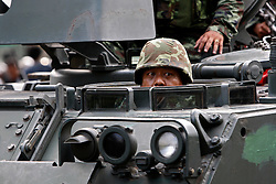 A Thai soldier looks out from an army tank as they prepare to crack down on anti-government protesters gathered outside Government House early morning in Bangkok, Thailand, 14 April 2009. Anti-government protests that shut down a weekend summit meeting and ruined Bangkok's annual Buddhist New Year celebrations ended suddenly 14 April after Thai army troops advanced on the demonstrators' last stronghold in Bangkok.
