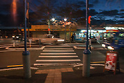 FULL FRONT COVER IMAGE from Te Atatu Me: Photographs of an urban New Zealand Village by John B Turner. Te Atatu Road crossing at night, 17 June 2010. (JBT&copy;20100617-068)<br /> <br /> These photographs of everyday life in Te Atatu Peninsula, West Auckland, were captured for posterity between 2005 and 2012. They are included in my book, 'Te Atatu Me: photographs of an urban New Zealand village by John B Turner', with an historical essay by Grant Cole. It will be published in early 2015 by PhotoForum Inc., NZ, and Turner PhotoBooks, with distribution by Rim Books (info@rimbooks.com).