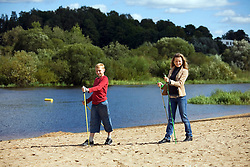 Teenage boy and young woman doing nordic walking