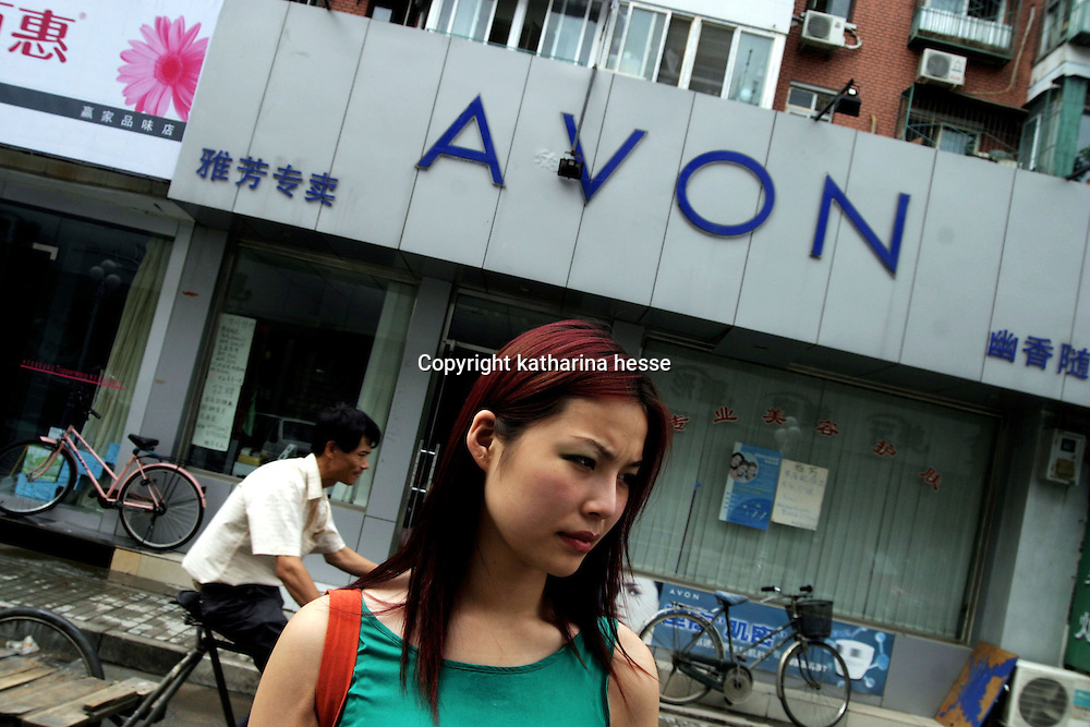 """BEIJING, 29.July 2004 : Yang Yuan, 19, an aspiring model who made headlines in May when she sued the organizer of a beauty pageant, stands in  a street outside the hospital where she went under the knife in Beijing, July 29, 2004, in China. ..Yang Yuan says she wanted to improve her career chances and therefore improved her looks artificially.When the organizer of the beauty contest found out, he banned her from competing and Yang's """"nightmare"""" started. Yang has spent a fortune to pay her team of lawyers, organize press conferences to fight for her rights...These days, she's been obliged to give up her apartment as she slowly runs out of money and model jobs are not coming .In order to make a living, Yang agreed to act as an """"ambassador"""" for the hospital where she had her plastic surgery...Plastic surgery gradually is becoming big business in China's capital.  Since this summer , hospitals  have been flooded with teenage patients ever since offers """"special summer reductions"""" for students were made..  ..Whereas in Mao Zedong's China, even pigtails were seen as a sign of vanity (and had to be cut off) , nowadays, urban Chinese women seek about every means in order to distinguish themselves from the masses.  This year Beijing will organize the worl'd first beauty pageant for women had had plastic surgery..."""