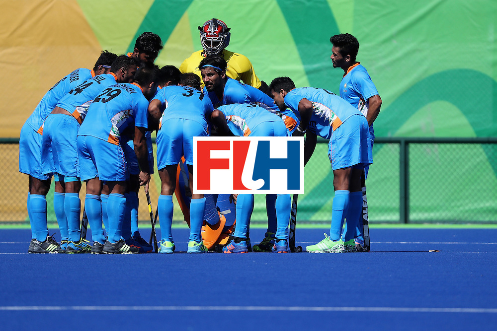 RIO DE JANEIRO, BRAZIL - AUGUST 06:  Team India huddle during a Pool B match between Ireland and India on Day 1 of the Rio 2016 Olympic Games at the Olympic Hockey Centre on August 6, 2016 in Rio de Janeiro, Brazil.  (Photo by Sean M. Haffey/Getty Images)