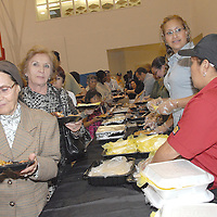 Guests eat dinner provided by El Pollo Loco at the Santa Monica YMCA  during the National Center on Addiction Substance Abuse's (CASA) Family Day - A Day to Eat Dinner with Your Children(TM) on Tuesday, September, 28, 2010.