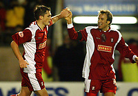 Photograph: Scott Heavey.<br />Walsall v Bradord City. Nationwide Division One. 06/12/2003.<br />Gary Birch celebrates his and the only goal of the game with Paul Merson