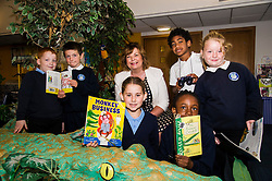 Pictured: Callum McCallion (7), Sean McNeil (8) Markus Rawalai (8), Sarah Keir (8) Glidh Stewart (7) and Anjola Abiadum Emmanuel (7) joined Ms Hyslop to check out some books.<br /> Culture Secretary Fiona Hyslop MSP visited Wester Hailes Library in Edinburgh today to meet primary-school pupils and Edinburgh City Council officials  to announce libraries support package<br /> <br /> Ger Harley | EEm 7 September 2016