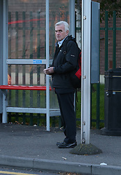 © Licensed to London News Pictures. 14/10/2015. London, UK. Labour Shadow chancellor John McDonnell waits at a bus stop.  Photo credit: Peter Macdiarmid/LNP