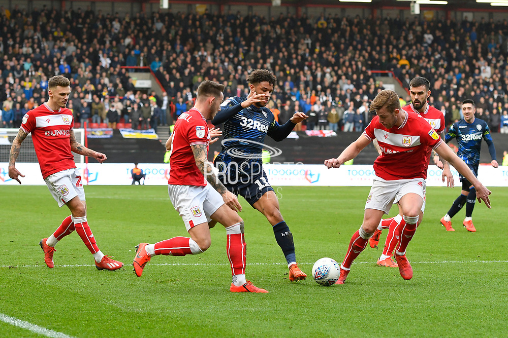 Tyler Roberts (11) of Leeds United trys to find a way through the Bristol defence during the EFL Sky Bet Championship match between Bristol City and Leeds United at Ashton Gate, Bristol, England on 9 March 2019.