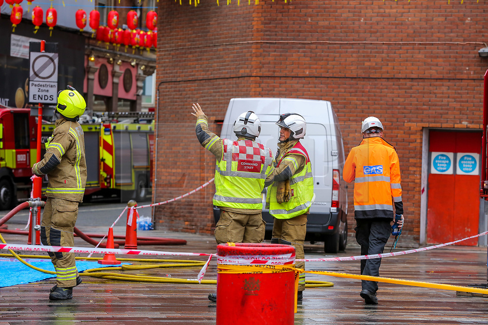 © Licensed to London News Pictures. 22/09/2019. London, UK. Fire crew at New China restaurant in London's Chinatown following a fire this morning. According to London Fire Brigade two people were rescued from a blaze at the Chinese restaurant in Gerrard Place where parts of the first and second floors and a section of the roof were alight. Photo credit: Dinendra Haria/LNP