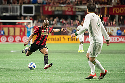 December 8, 2018 - Atlanta, Georgia, United States - Atlanta United midfielder DARLINGTON NAGBE (6) looks to cross the ball while Portland Timbers defender JORGE VILLAFANA (4) looks on during the MLS Cup at Mercedes-Benz Stadium in Atlanta, Georgia.  Atlanta United defeats Portland Timbers 2-0 (Credit Image: © Mark Smith/ZUMA Wire)