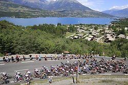 The peloton start to climb Cote de Demoiselles Coiffees at Lac de Serre-Poncon during Stage 18 of the 104th edition of the Tour de France 2017, running 179.5km from Briancon to the summit of Col d'Izoard, France. 20th July 2017.<br /> Picture: Eoin Clarke | Cyclefile<br /> <br /> All photos usage must carry mandatory copyright credit (© Cyclefile | Eoin Clarke)