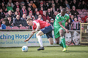 Ntumba Massanka (on loan from Burnley) (Wrexham AFC) and Danny Parslow (York City) try to get onto the ball during the Vanarama National League match between York City and Wrexham FC at Bootham Crescent, York, England on 17 April 2017. Photo by Mark P Doherty.