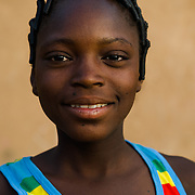 Rihanata Ouedraogo (15), pictured in Koala, Burkina Faso on 1 March 2014, spends over three hours a day fetching untreated water from a dam to meet the needs of herself and her large extended family. If she did not have to collect water, she says she would use the time saved to study.