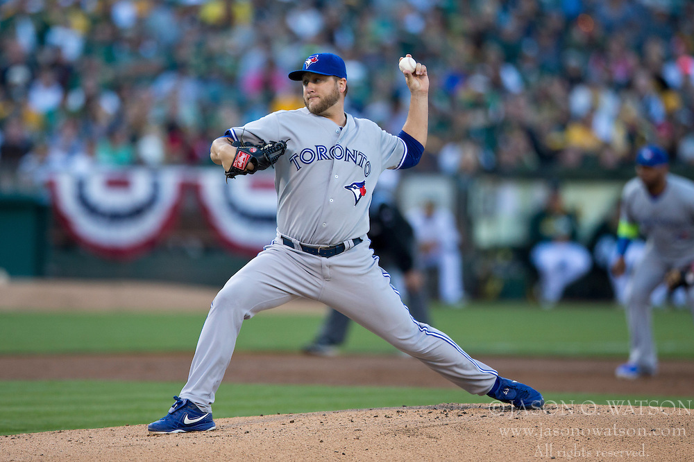 OAKLAND, CA - JULY 05:  Mark Buehrle #56 of the Toronto Blue Jays pitches against the Oakland Athletics during the first inning at O.co Coliseum on July 5, 2014 in Oakland, California. (Photo by Jason O. Watson/Getty Images) *** Local Caption *** Mark Buehrle
