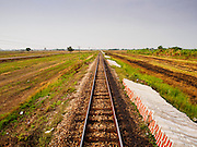 20 MARCH 2015 - PRACHINBURI, PRACHINBURI, THAILAND: Tracks of the eastern line of the State Railways of Thailand. The State Railways of Thailand (SRT), established in 1890, operates 4,043 kilometers of meter gauge track that reaches most parts of Thailand. Much of the track and many of the trains are poorly maintained and trains frequently run late. Accidents and mishaps are also commonplace. Successive governments, including the current military government, have promised to upgrade rail services. The military government has signed contracts with China to upgrade rail lines and bring high speed rail to Thailand. Japan has also expressed an interest in working on the Thai train system. Third class train travel is very inexpensive. Many lines are free for Thai citizens and even lines that aren't free are only a few Baht. Many third class tickets are under the equivalent of a dollar. Third class cars are not air-conditioned.  PHOTO BY JACK KURTZ