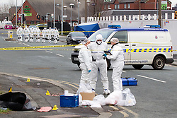 © licensed to London News Pictures. Salford, UK 27/12/2011. Police guard the scene of the murder of Indian student Anuj Bidve, as forensic officers search the area for evidence. The Lancaster University student was enjoying Christmas in Manchester with friends. He was shot in the head on Ordsall Lane in Salford. Photo credit should read Joel Goodman/LNP