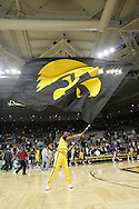 24 JANUARY 2007: An Iowa cheerleader waves the Hawkeye banner after Iowa's 79-63 win over Penn State at Carver-Hawkeye Arena in Iowa City, Iowa on January 24, 2007.