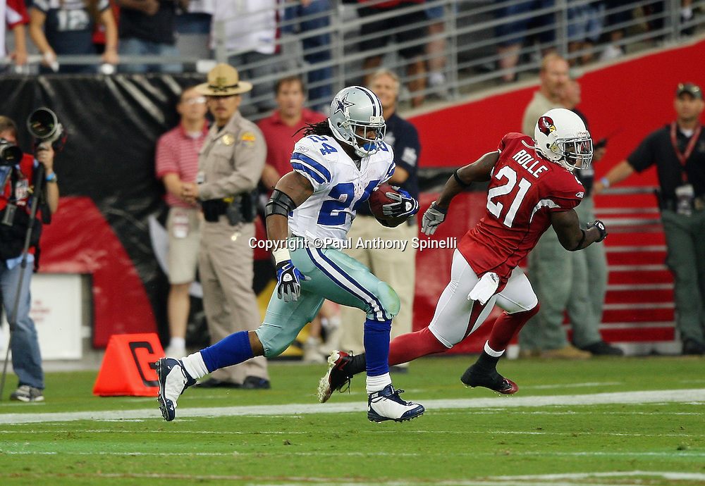 GLENDALE, AZ - OCTOBER 12: Running back Marion Barber #24 of the Dallas Cowboys catches a 70 yard fourth quarter touchdown pass while covered by Antrel Rolle #21 of the Arizona Cardinals at University of Phoenix Stadium on October 12, 2008 in Glendale, Arizona. The Cardinals defeated the Cowboys 30-24. ©Paul Anthony Spinelli *** Local Caption *** Marion Barber;Antrel Rolle