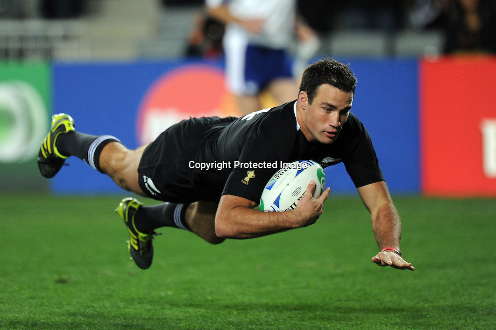 Richard Kahui dives in for a try during the New Zealand All Blacks versus Tonga opening pool A match of the 2011 IRB Rugby World Cup. Eden Park, Auckland, New Zealand. Friday 9 September 2011. Photo: Andrew Cornaga / Photosport.co.nz