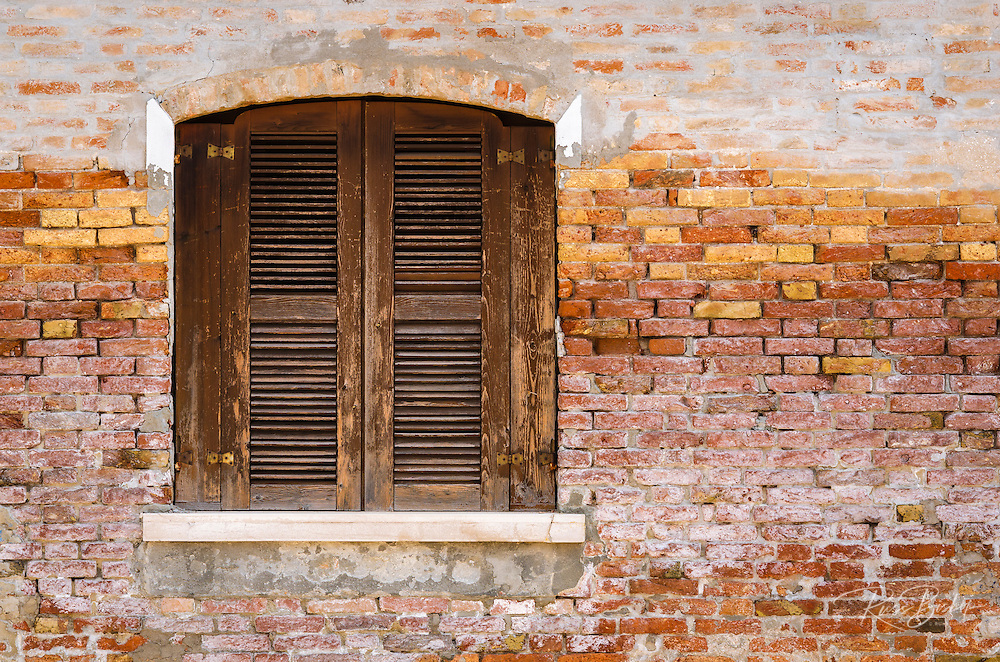 Wooden shutters and brick wall, Burano, Veneto, Italy