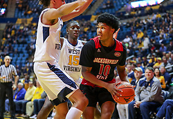 Dec 22, 2018; Morgantown, WV, USA; Jacksonville State Gamecocks guard Maurice Dunlap (10) is trapped by West Virginia Mountaineers defenders during the first half at WVU Coliseum. Mandatory Credit: Ben Queen-USA TODAY Sports