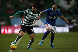 December 1, 2017 - Lisbon, Portugal - Sporting's defender Cristiano Piccini  (L) vies for the ball with Belenenses's midfielder Andre Sousa (R)  during Primeira Liga 2017/18 match between Sporting CP vs CF Belenenses, in Lisbon, on December 1, 2017. (Credit Image: © Carlos Palma/NurPhoto via ZUMA Press)