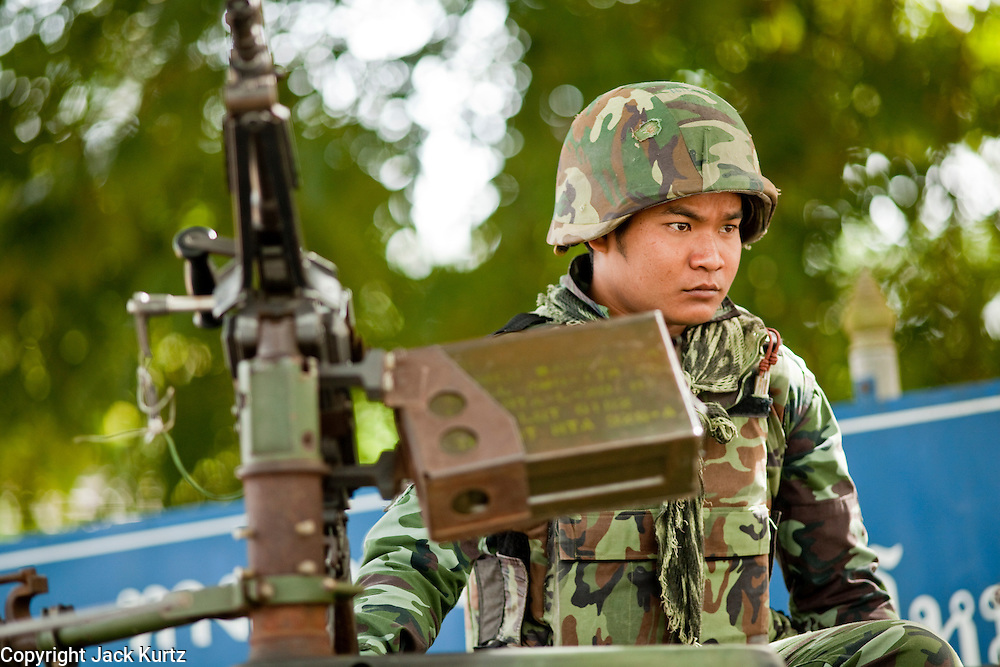 """Sept. 27, 2009 -- PATTANI, THAILAND: A Thai soldier with a machine gun mans a checkpoint during a security operation in Pattani, Thailand. Thailand's three southern most provinces; Yala, Pattani and Narathiwat are often called """"restive"""" and a decades long Muslim insurgency has gained traction recently. Nearly 4,000 people have been killed since 2004. The three southern provinces are under emergency control and there are more than 60,000 Thai military, police and paramilitary militia forces trying to keep the peace battling insurgents who favor car bombs and assassination.   Photo by Jack Kurtz / ZUMA Press"""