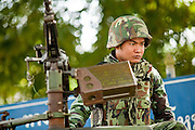 "Sept. 27, 2009 -- PATTANI, THAILAND: A Thai soldier with a machine gun mans a checkpoint during a security operation in Pattani, Thailand. Thailand's three southern most provinces; Yala, Pattani and Narathiwat are often called ""restive"" and a decades long Muslim insurgency has gained traction recently. Nearly 4,000 people have been killed since 2004. The three southern provinces are under emergency control and there are more than 60,000 Thai military, police and paramilitary militia forces trying to keep the peace battling insurgents who favor car bombs and assassination.   Photo by Jack Kurtz / ZUMA Press"