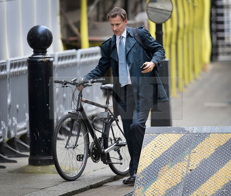 © Licensed to London News Pictures. 15/05/2017. London, UK. Health Secretary Jeremy Hunt wheels his bike into Downing Street in Westminster, London ahead of a COBRA meeting. Members of British government are meeting to discuss the recent cyber attack on over 150 countries, which crippled parts of the NHS.  Photo credit: Peter Macdiarmid/LNP